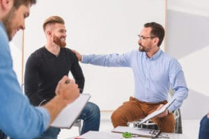 therapist supporting a man as he explains what is cognitive behavioral therapy
