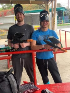 two men ready to paintball for experiential and adventure-based program at The District