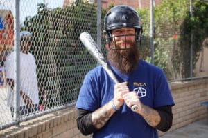 man ready to bat for Softball Team at the District's adventure-based program