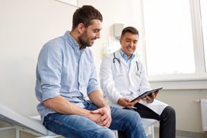 outpatient treatment doctor meeting with man