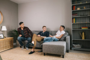 men on a couch discussing What to Expect From Sober Living