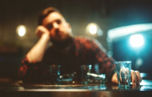 an image of a person who is drinking and may also be dealing with a dual diagnosis